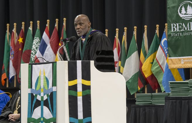 The Honorable Alan C. Page, Minnesota's first African-American supreme court justice, former Minnesota Vikings player and pro football Hall of Fame inductee, applauded the centennial class of graduates for their dedication to completing their education.