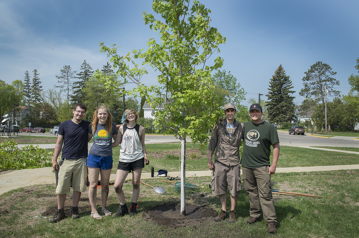 Jacob Haley, Anna Haynes, Skye Iwanski, Jordan Lutz and Benjamin Ng pictured in front of the Autumn blaze they planted.