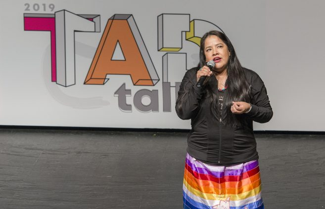 Christal Moose, manager of Native Pride Dancers, introduced fancy danced Larry Yazzie.