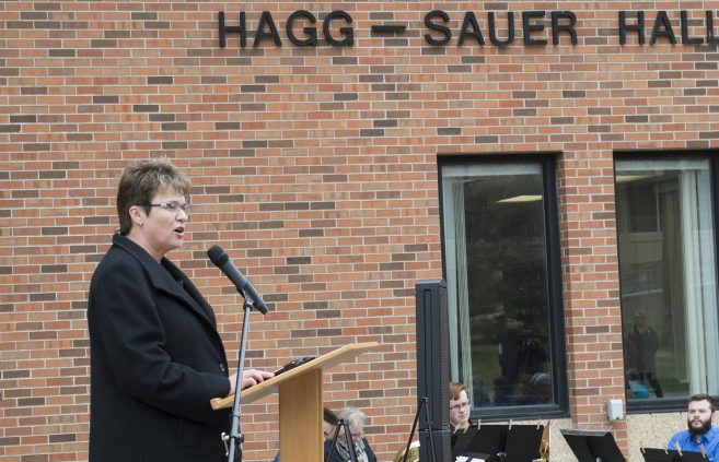 President Faith C. Hensrud encouraged attendees to cherish their memories of Hagg-Sauer hall.