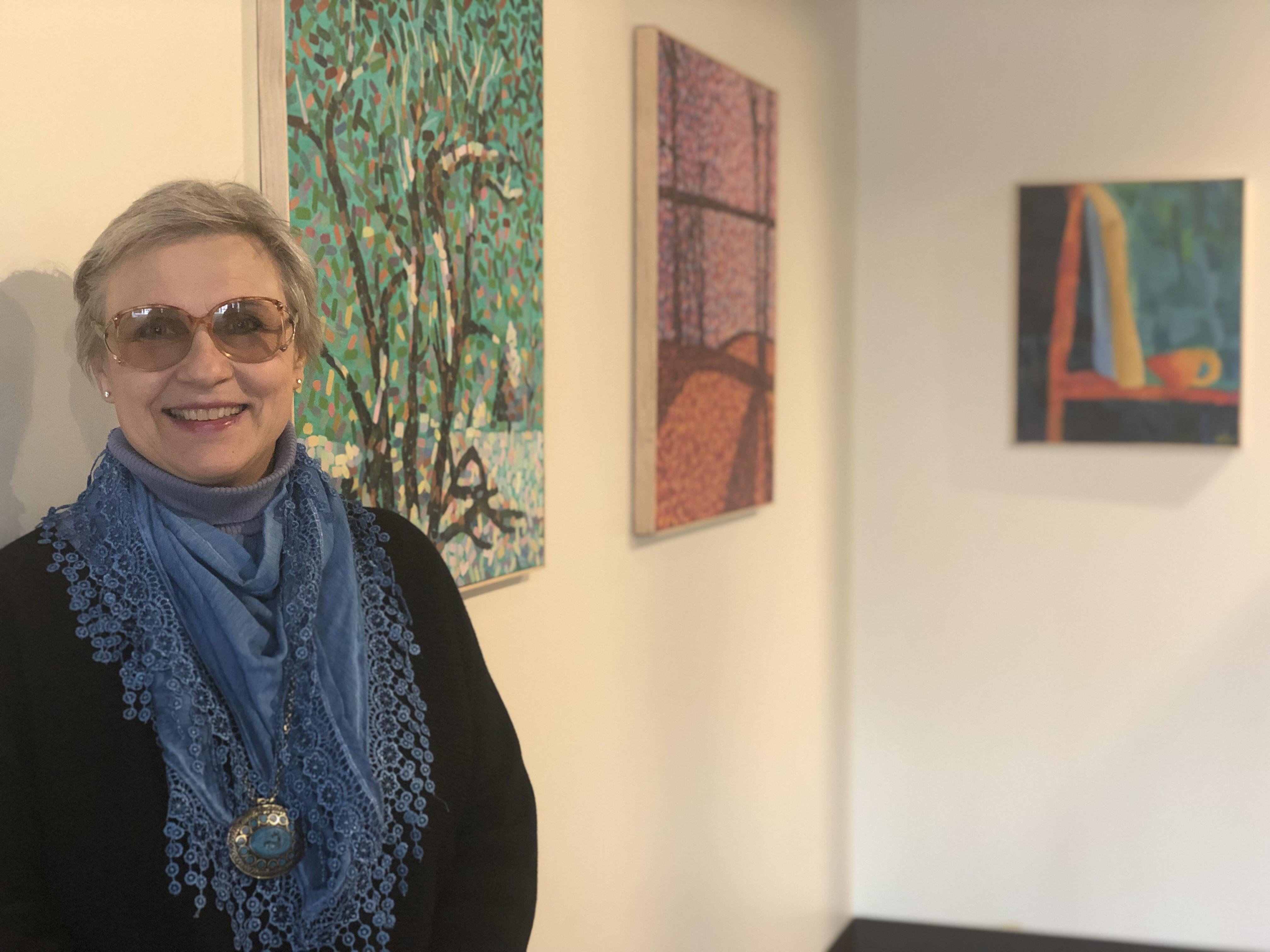 Natalia Himmirska with the student artwork.