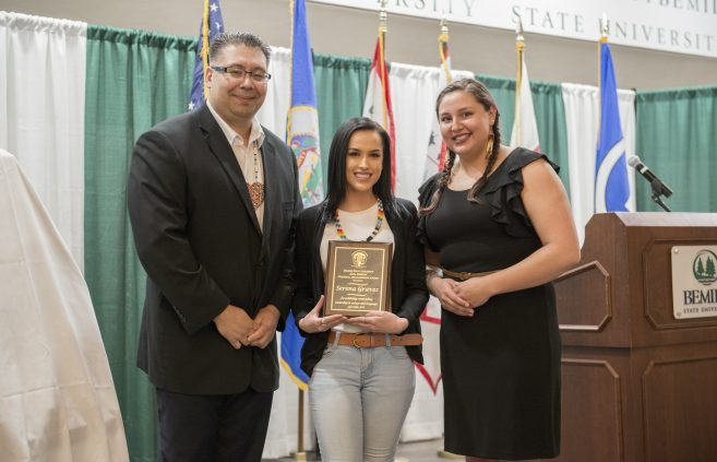 Student Serena Graves receiving the Earl Nyholm Culture and Language Award at the American Indian Resource Center Awards Banquet.