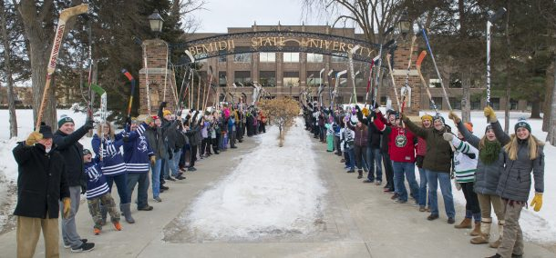A hundred people gathered for the world's largest hockey stick salute for Hockey Day Minnesota weekend.