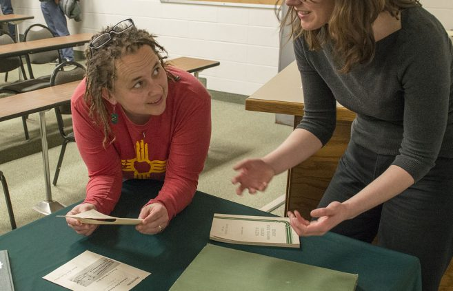 Colleen Deel and Mary Overlie examine artifacts following Deel's Honors Council Lecture on the university archives