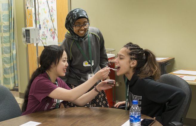 Students learning skills at Scrubs Camp.