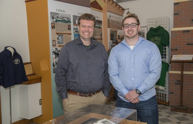 John Ellis, assistant professor of history, and Brian Ditton, BSU grad at the display.