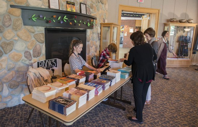 Interns selling books during Dustin Parsons' Craft Talk.