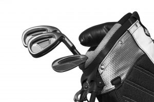 Golf clubs in golf bag. Black and white shot.