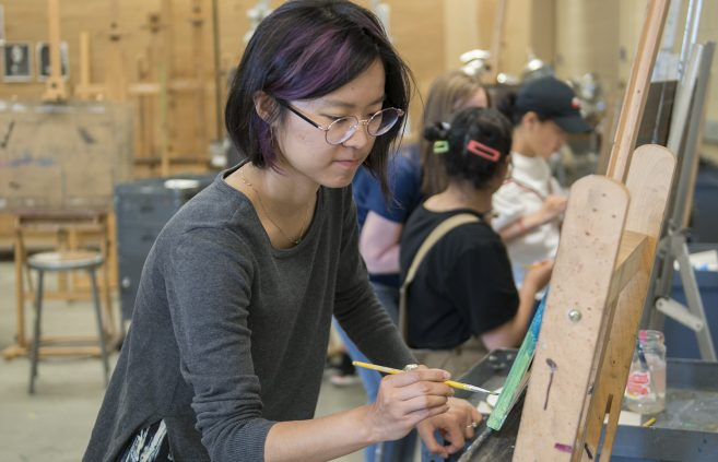 Jo Li, Northstar Visiting Scholar coordinator, creating artwork with camp attendees.