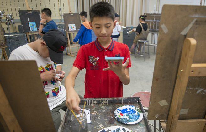 Camp attendees creating artwork.