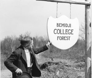 """Dr. Claude Vivian """"Mr. Conservation"""" Hobson and the first school forest sign."""