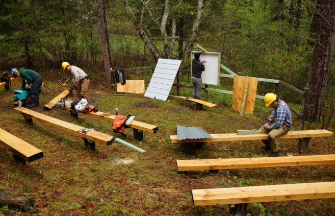 Conservation Corp of Minnesota crew members working on the amphitheater and instruction board.