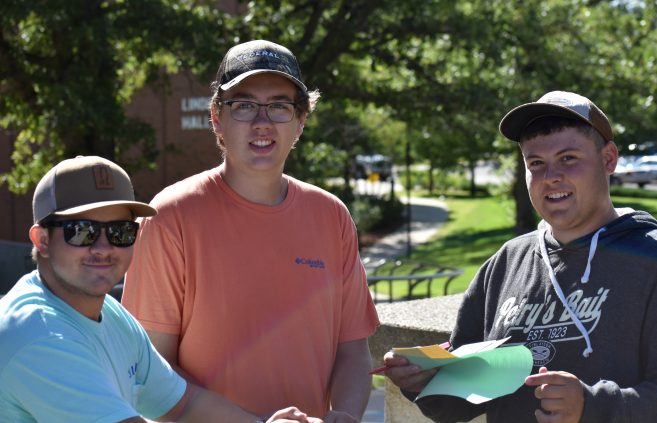 New students smile for a photo as they wait for orientation weekend activities.