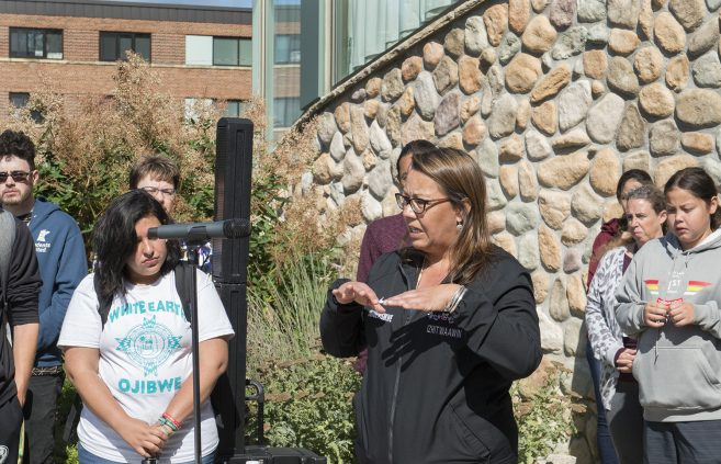 Laurie Harper, director of education for the Leech Lake Band of Ojibwe, gave a blessing for the school year ahead.