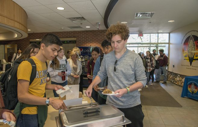 Students enjoying a free meal at the American Indian Resource Center's 12th annual Day of Welcome.