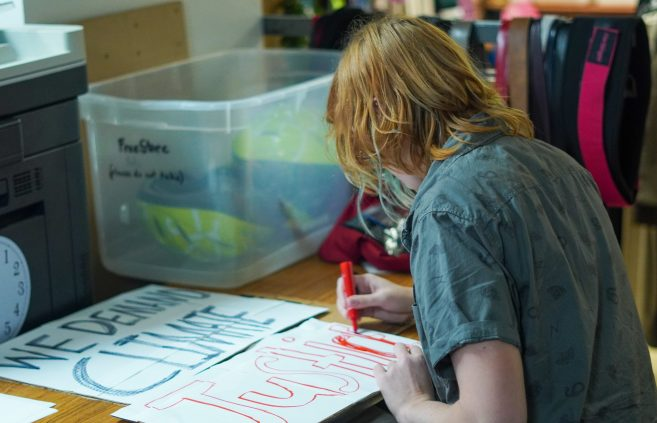Participants making signs for the climate march.