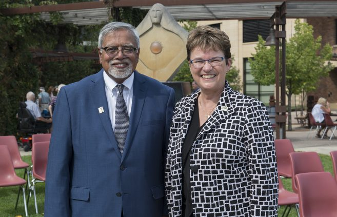Chancellor Devinder Malhotra with President Faith C. Hensrud.