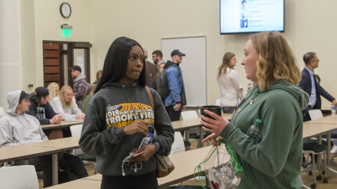 A student talks with Rachel Munson, '15 alumnae of BSU, after the Alumni Leaders in the Classroom panel.