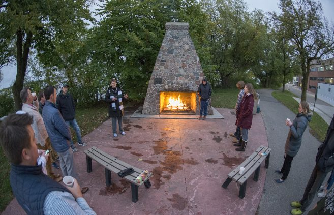 President Faith C. Hensrud, Josh Christianson, executive director of university advancement, Matthew Sauser, student body president and Noah Wendland, student body vice-president joined together to ignite the Homecoming Flame in the historic BSU fireplace near Lake Bemidji.