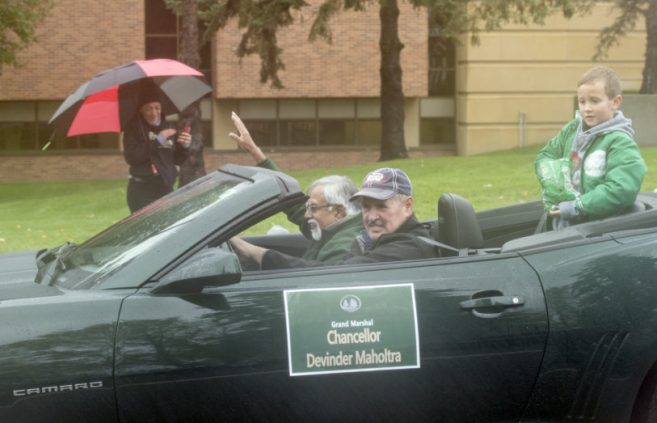 Devinder Malholtra, chancellor of Minnesota State, braved the elements in an open convertible as the parade's grand marshal.