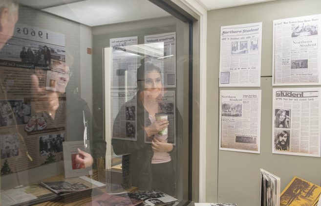 BSU student and President Hensrud observing the centennial gallery