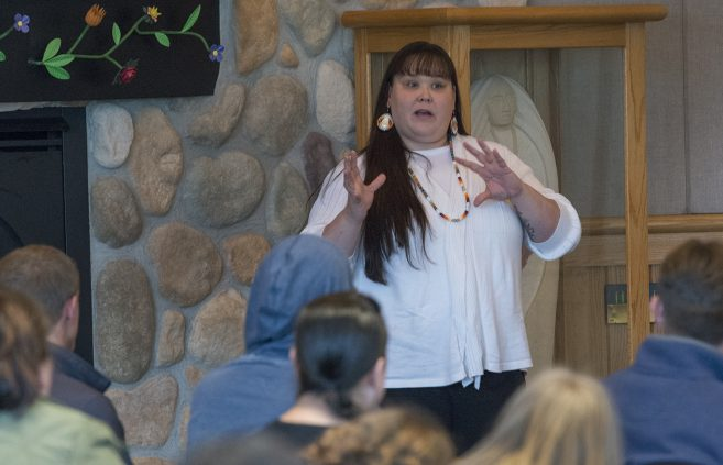 Chrissy Koch, outreach specialist at the American Indian Resource Center speaking at the event.