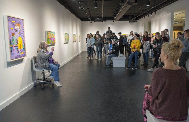 Paula Swenson speaking at her artist reception.
