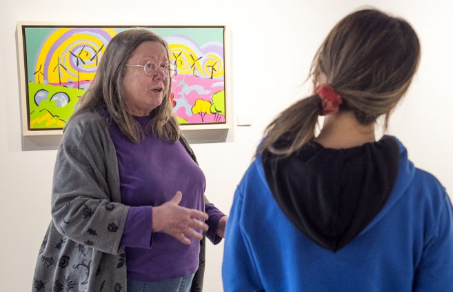 Paula Swenson speaking with a TAD student.