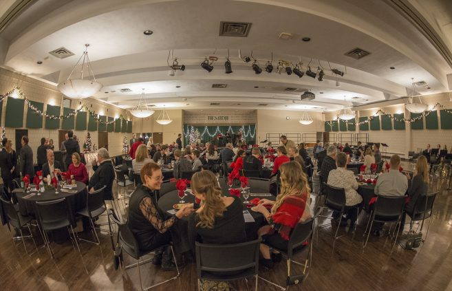 A full room of guests in the Beaux Arts Ballroom decorated for the holiday.