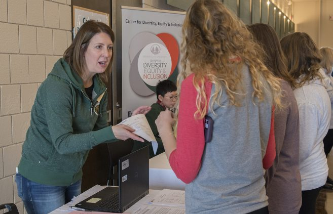 Assistant Director of Financial Aid Jodi Knott speaks with a prospective student