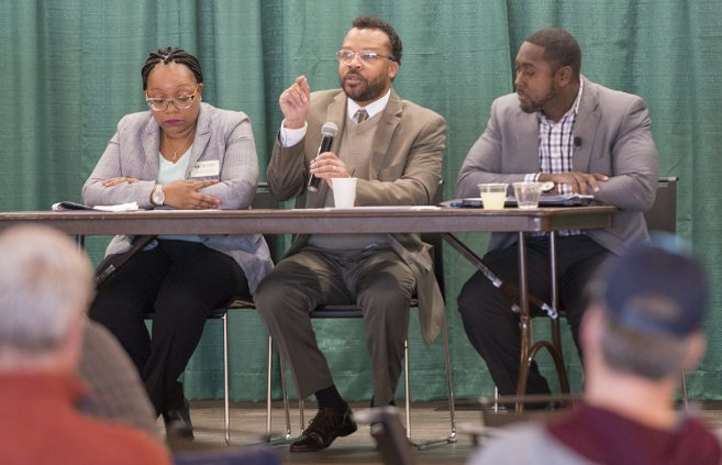 Drs. Egypt Grandison, David Frison and Gabriel Warren, assistant professors of business administration speaking at the panel discussion.