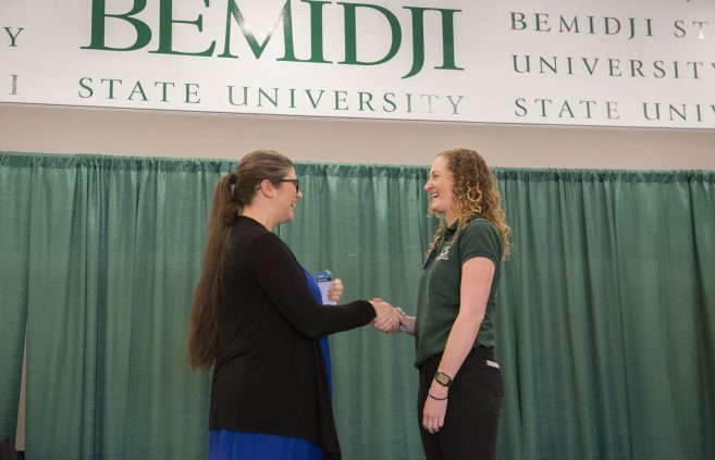 Newly inducted nursing student receiving her name badge.