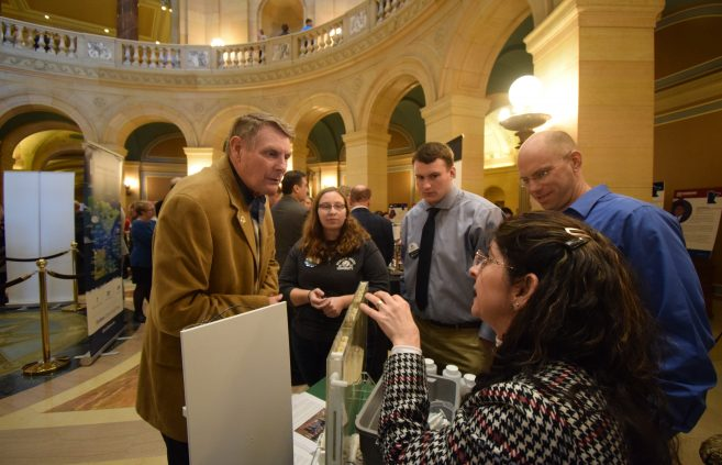 Dr. Isaacson and Dr. Rios-Sanchez, along with students from BSU's Center for Sustainability Studies, showcasing their research as John Persell, politician and member of the Minnesota House of Representatives, observes.