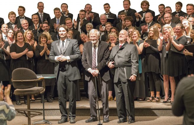 Dr. Dwight Jilek (left) welcomed Dr. Paul Brandvik (center) home to conduct an alumni performance at the Bemidji Choir's 80th anniversary celebration in 2017.