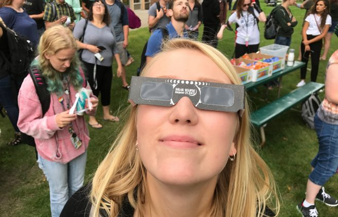 A student views the 2018 solar eclipse.