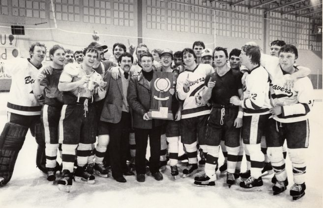 """Legendary hockey coach R.H. """"Bob"""" Peters celebrates BSU's 1984 national championship to cap an undefeated season."""