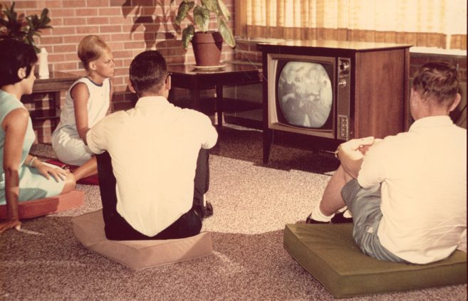 Students on campus watch television, 1960s.