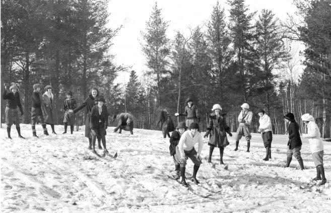 Students enjoy a winter snowfall.