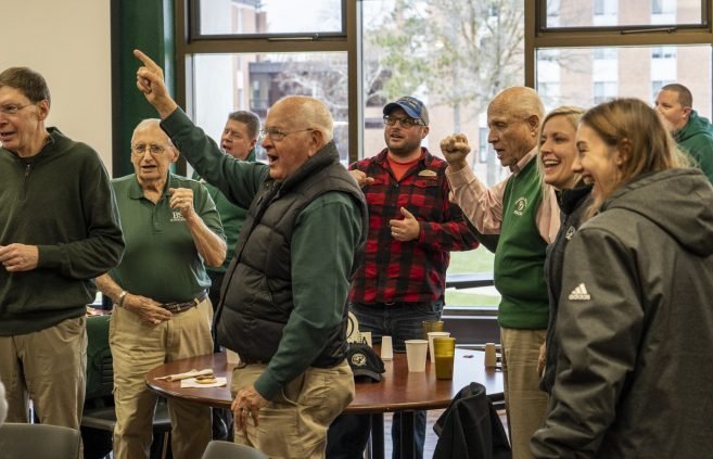 Former BSU president Jim Bensen '59 leads the BSU fight song at a Beaver Pride Luncheon in Upper Deck.