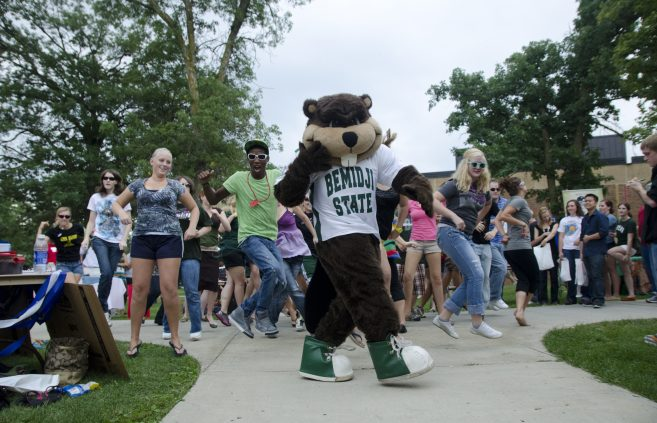 Bucky leads a dance party on campus.