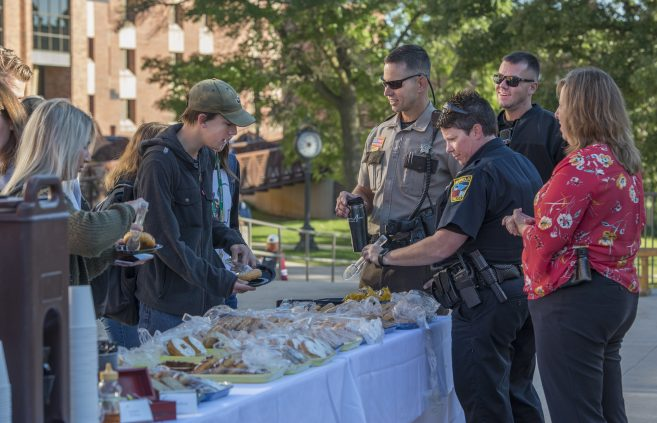 """Students enjoy donuts with the Beltrami County Sheriff's Office during the seventh annual """"Breakfast with the Cops"""" event."""