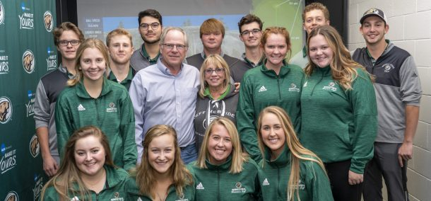 "BSU golf teams pose with Gary and Ruth McBride at the dedication of the Jeff ""Bird"" McBride Clubhouse on Nov. 2"