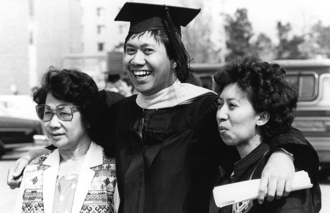 A student and his family celebrate graduation, late 1990s.