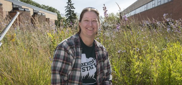 Rachel Schapp standing in front of the BSU butterfly garden