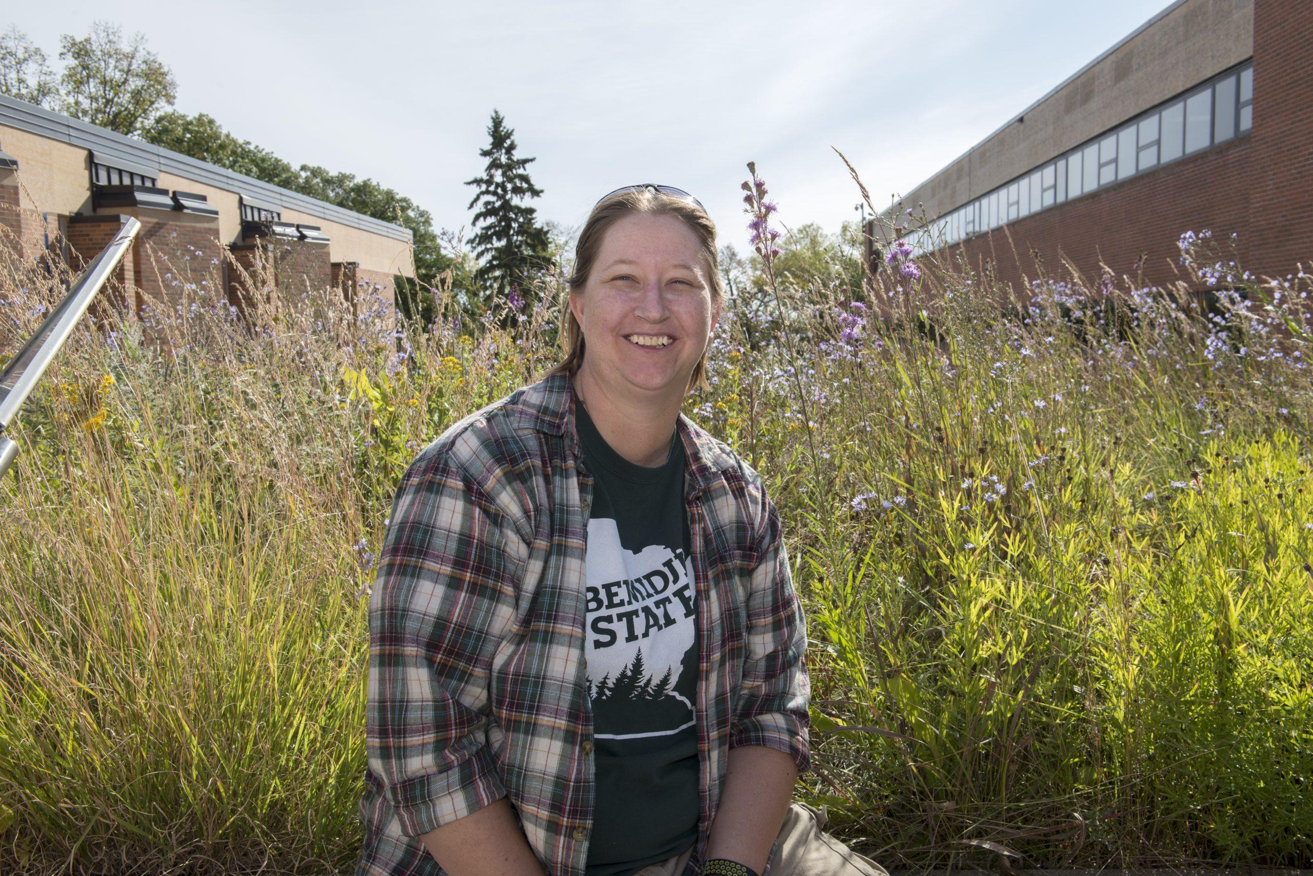 Rachel Schapp standing in front of the BSU butterfly garden