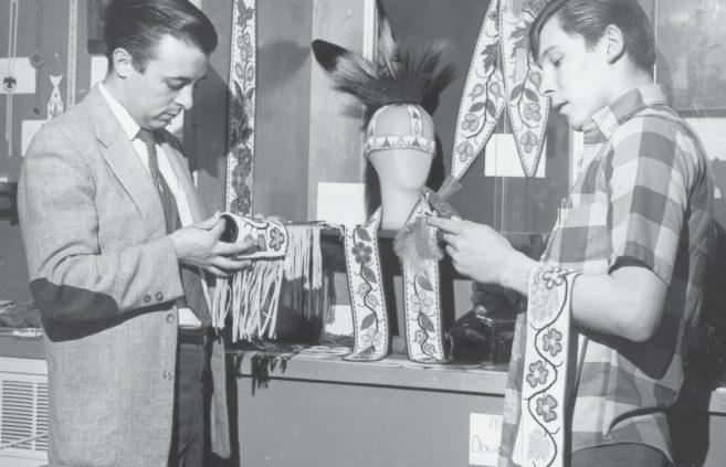 Examining beadwork in an early Ojibwe course at Bemidji State.