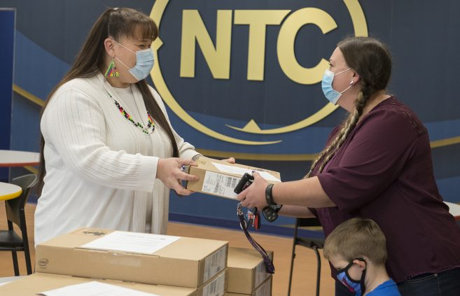 Chrissy Koch, executive director of the American Indian Resource Center, distributing Laptops to Students Awarded COVID-19 Relief Grants.