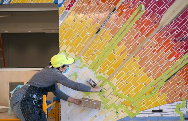 Stacia Goodman working on the Mosaic Installation