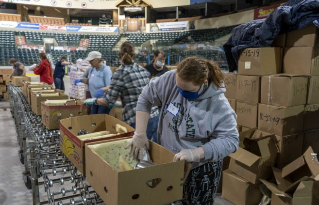 In April dozens of BSU volunteers gathered at Sanford Center to help Ruby's Pantry pack meals for local residents