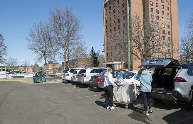 On March 30, BSU students packs their vehicle and prepare to leave campus.